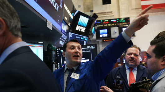 Dow ends at record after briefly crossing 23000 points