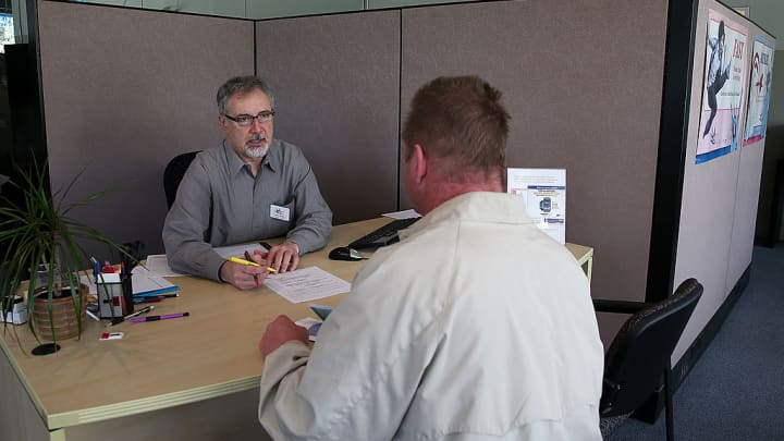 Am accountant helps a customer prepare his income taxes on April 14, 2014 in San Francisco, California.