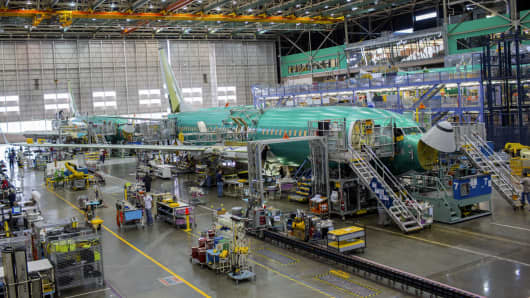 Workers assemble a Boeing 737 airplane at the company's factory in Renton, Washington