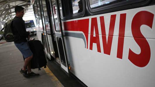 A customer boards an Avis Budget Group Inc. shuttle bus at the Denver International Airport (DEN) in Denver, Colorado, U.S., on Wednesday, Oct. 28, 2015.