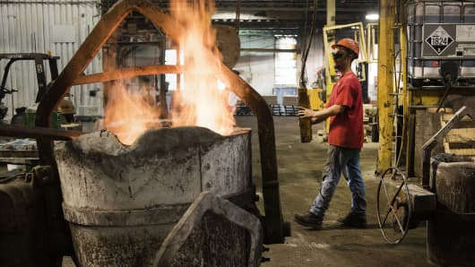 A ladle is set on fire and heated to the correct temperature during the smelting process at the Quaker City Castings facility in Salem, Ohio.
