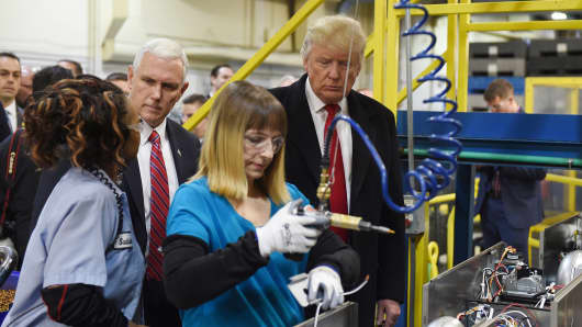 Then-President-elect Donald Trump and Vice President-elect Governor Mike Pence visit the Carrier air conditioning and heating company in Indianapolis, Indiana on December 1, 2016.