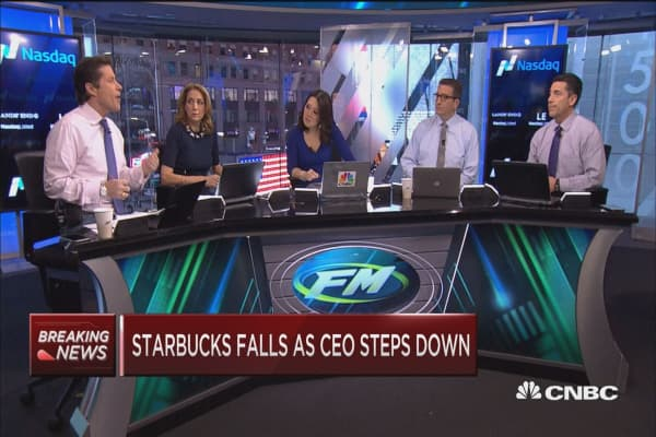 Starbucks falls as CEO steps down