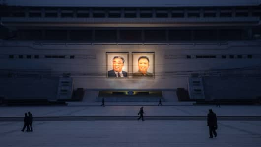 Portraits of late North Korean leaders Kim Il-Sung (L) and Kim Jong-Il (R) in Pyongyang on December 1, 2016.