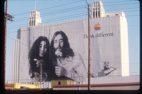 "A billboard of Apple's ""Think Different"" campaign with Yoko Ono and John Lennon in Los Angeles, California in 1998"