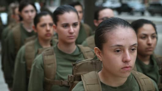 Female Marine recruits stand in formation during boot camp February 25, 2013 at MCRD Parris Island, South Carolina.