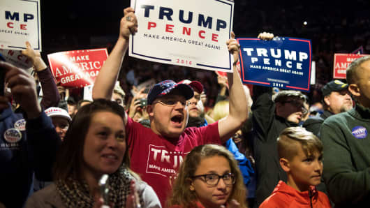 Supporters listen as President-elect Donald Trump and Vice President-elect Mike Pence speak at U.S. Bank Arena on Dec. 1, 2016, in Cincinnati.