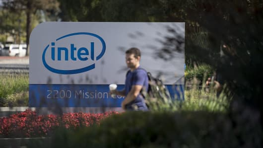 A pedestrian walks past Intel Corp. signage at the entrance to the company's headquarters in Santa Clara, California.