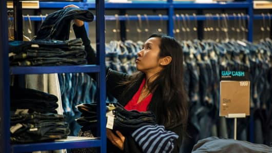 A customer browses jeans at a Gap store in San Francisco.