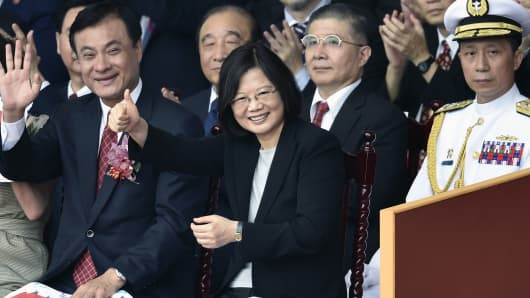 Taiwan President Tsai Ing-wen (C) gestures during National Day celebrations in front of the Presidential Palace in Taipei on October 10, 2016.
