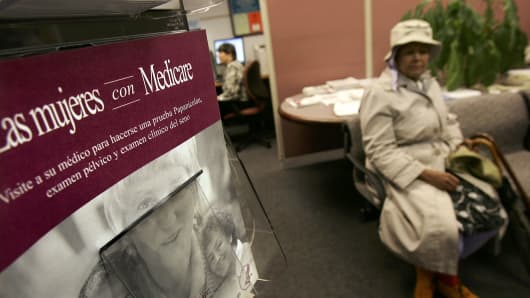 A woman waits to speak with Medicare consultants for enrollment in the Medicare Part D program in New York City.