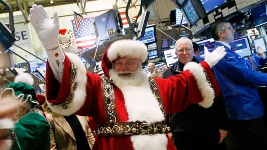 A man dressed as Santa Claus walks the floor of the New York Stock Exchange.