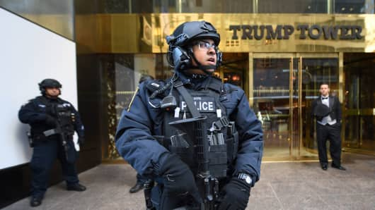 In this file photo, a member of the New York Police Department stands in front of Trump Tower on Fifth Avenue.