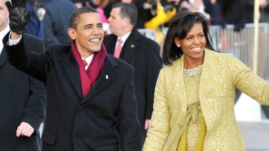 President Barack Obama and first lady Michelle Obama walk in the Inaugural Parade on January 20, 2009 in Washington, DC.