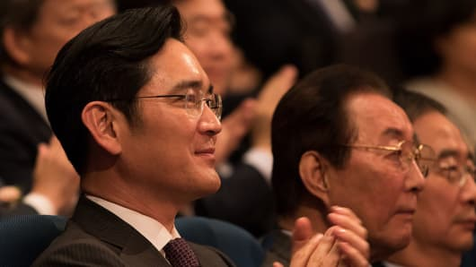 Jay Y. Lee, vice chairman of Samsung Electronics, applauds during a ceremony.