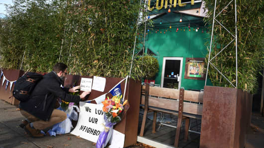 Jared Peterson leaves a sign outside Comet Ping Pong on Monday, Dec. 5, 2016, in Washington, DC.