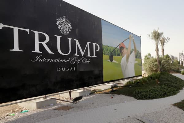 Donald Trump is seen playing golf on a billboard at the Trump International Golf Club Dubai in the United Arab Emirates on August 12, 2015.