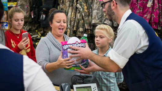 Kelly Ingram reacts while receiving a Hatchimal, a top toy of the season, at Walmart's Black Friday event in Bentonville, AR on Nov. 24, 2016.