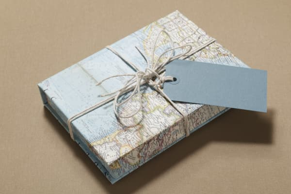 Clever wrapping paper and a handwritten note can turn a re-gifted item into a gem.