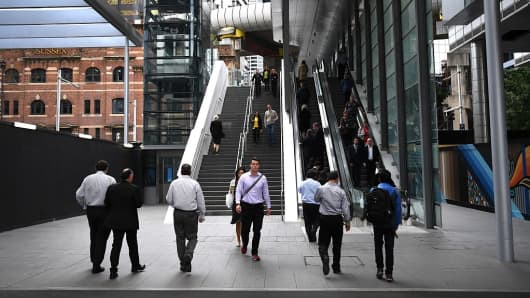 People walk to work in Sydney on September 21, 2016.