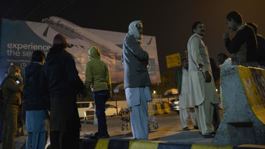Relatives of the plane crash victims are seen outside the Benazir International Airport in Islamabad, Pakistan, on December 7, 2016.