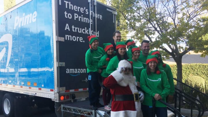 Amazon trucks will be delivering winter clothing, toys and household essentials to families in need across America this holiday season.