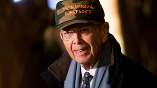 Wilbur Ross, President-elect Donald Trump's choice for Commerce Secretary, wears a 'Make America Great Again Hat' as he speaks briefly to reporters at Trump Tower, November 29, 2016 in New York City.