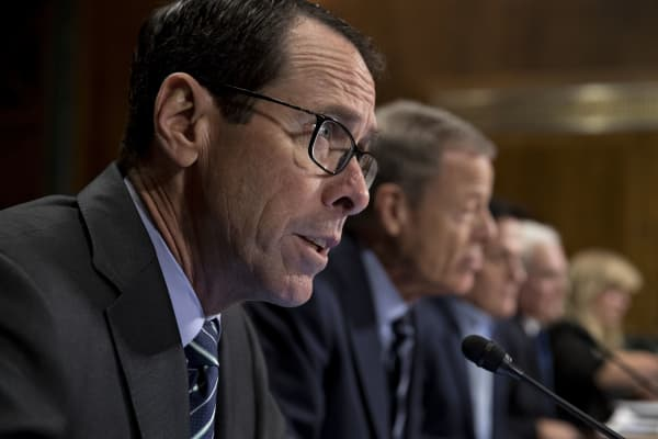 Randall Stephenson, chairman and chief executive officer of AT&T, speaks during a Senate hearing, Dec. 7, 2016.