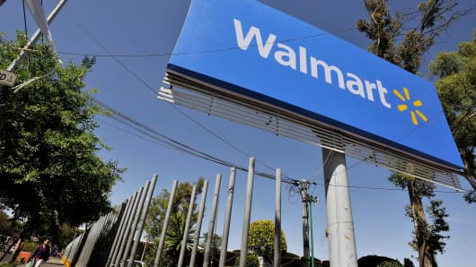 Wal-Mart signage is seen in the parking lot of the store on April 23, 2012 in Mexico City, Mexico.