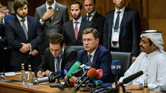 Russian Energy Minister Alexander Novak (C) speaks next to Mohammed bin Saleh al-Sada (R), President of the Organisation of Petroleum Exporting Countries (OPEC) during a press conference at the 23rd World Energy Congress on October 12, 2016 in Istanbul.