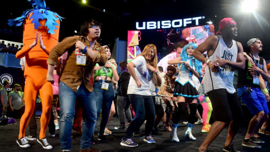 Dancers move to the beats from Ubisoft's 'Just Dance 2017' during a demo of new titles at the Los Angeles Convention Center during the second day of 2016 Electronic Entertainment Expo (E3) annual video game conference and show on June 15, 2016 in Los Angeles, California.