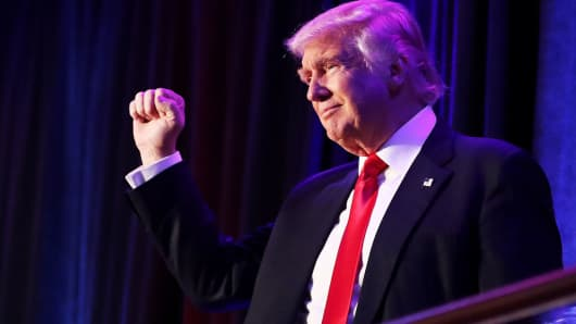 Republican president-elect Donald Trump acknowledges the crowd during his election night event at the New York Hilton Midtown in the early morning hours of November 9, 2016 in New York City.