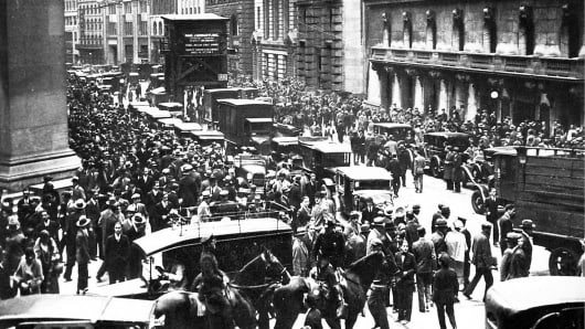 Crowds gather outside the New York Stock Exchange during the Wall Street crash in 1929.