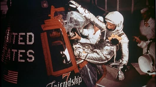 Astronaut John Glenn, Jr. is loaded into the Friendship 7 capsule in preparation for flight on the Mercury Titan rocket February 20, 1962.