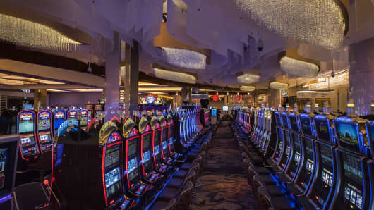 Slot machines beneath a fanciful ceiling treatment on the game floor of the new MGM National Harbor Casino, preparing to open next week, on December, 02, 2016 in Oxon Hill, MD.