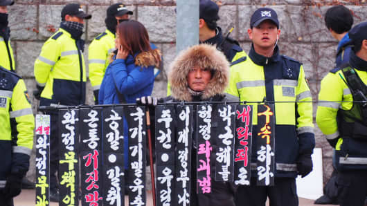 South Koreans are protesting at the National Assembly in Seoul as they urge for the impeachment of President Park Geun-Hye on December 9, 2016.