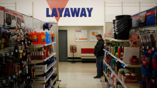 A shopper stands near the layaway counter at a Kmart discount store.