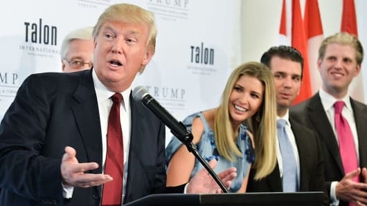 Donald Trump, Ivanka Trump, Donald Trump Jr. and Eric Trump attend the Grand Opening Ribbon Cutting Ceremony at the Trump International Hotel and Tower Toronto on April 16, 2012 in Toronto, Canada.