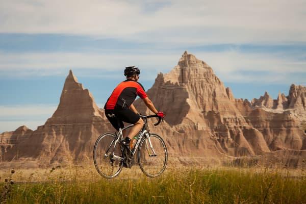 Man riding bike in Badlands National Park, South Dakota.