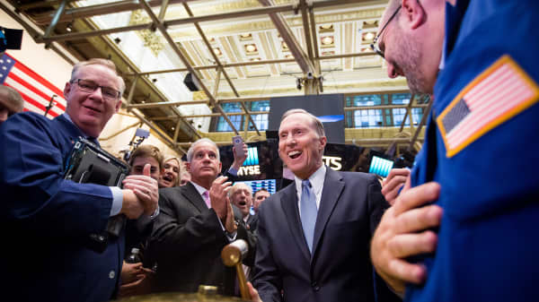James Belardi, chairman and chief executive officer of Athene Holding Ltd., center, rings a ceremonial bell on the floor the New York Stock Exchange (NYSE) during the initial public offering of the company's stock in New York, U.S., on Friday, Dec. 9, 2016.