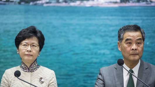 Carrie Lam (L) and Leung Chun-ying (R) attend a news conference in Hong Kong on November 7, 2016.