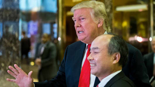 President-elect Donald Trump and SoftBank Group Corp. founder and Chief Executive Officer Masayoshi Son speak to the media in the lobby of Trump Tower on December 6, 2016 in New York.