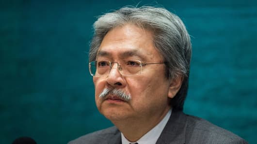 Financial Secretary John Tsang Chun-wah reacts during a press conference in the Central Governement office in Hong Kong on September 21, 2016.