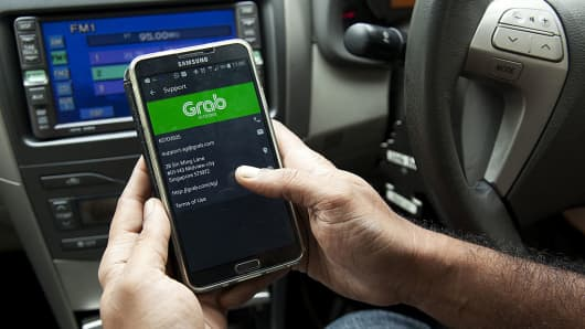 A GrabCar driver displays the support information page on the Grab app on a smartphone in an arranged photograph in Singapore, on Monday, Oct. 31, 2016.