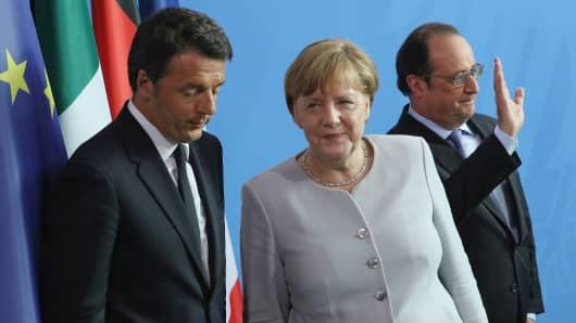 Angela Merkel, Francois Hollande (R) and Matteo Renzi depart after speaking to the media on June 27, 2016 in Berlin, Germany.