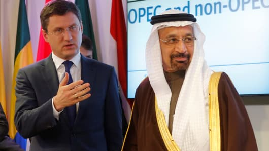 Russia's Energy Minister Alexander Novak (L) and Saudi Arabia's Energy Minister Khalid al-Falih leave a news conference after a meeting of the Organization of the Petroleum Exporting Countries (OPEC) in Vienna, Austria, December 10, 2016.