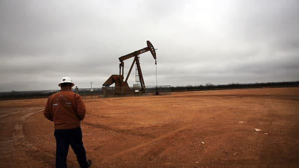 An oil well owned and operated by Apache Corporation in the Permian Basin of Garden City, Texas, on February 5, 2015.