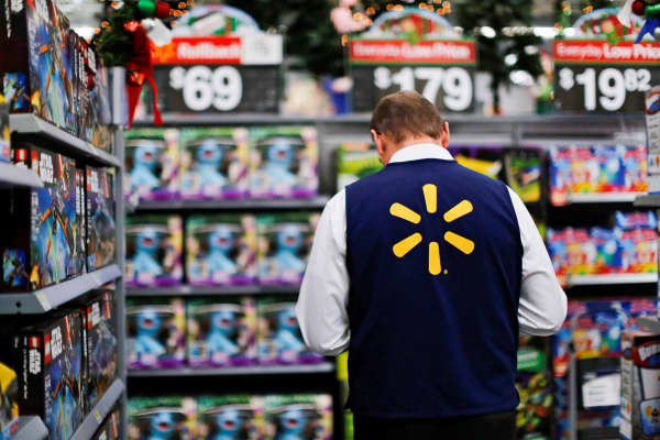 A Walmart worker organizes products for the Christmas season at a Walmart store in Teterboro, New Jersey.