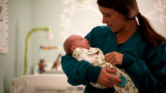 A mother holds her infant son Luke during a visit with him at Lily's Place, a treatment center for opioid-dependent newborns in Huntington, West Virginia, October 19, 2015.
