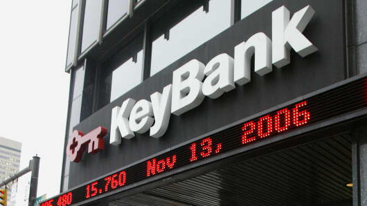 A KeyBank sign with a market ticker is seen on the facade of the KeyBank Building in Columbus, Ohio.